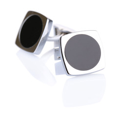 Pair of cuff links isolated on white