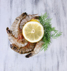 Martini glass of fresh tasty prawns with lemon and dill