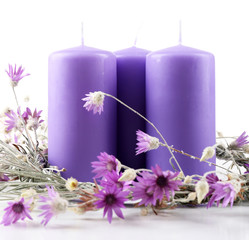 Candles with dried flowers isolated on white