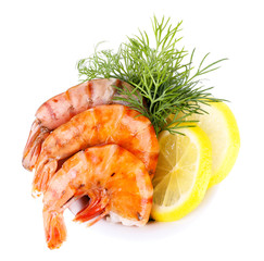 Fresh boiled prawns with dill and lemon in a blue round bowl
