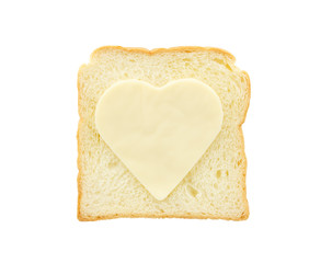 Heart shape cheese on bread