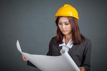 Asian engineer girl hold a blueprint