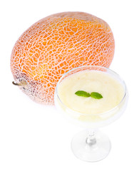 Melon smoothie in glass and melon isolated on white