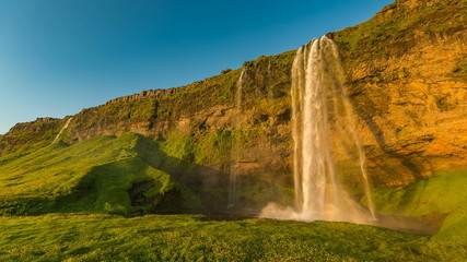 Wide angle of Seljalandsfoss waterfall during sunset in Iceland