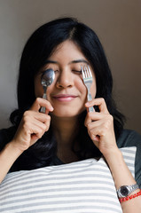 Funny woman with spoon and fork