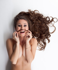 Cute girl posing topless with mustache of her hair