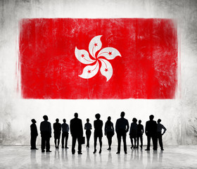 Silhouettes of Business People and Hong Kong Flag