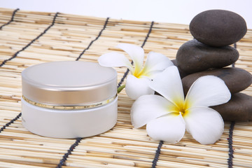 Frangipani moisturizer and polished stone