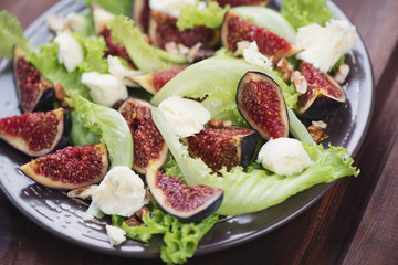 Fig fruits, cheese and walnuts salad, close-up, horizontal shot