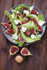 Figs, mozzarella and walnuts salad, above view, vertical shot