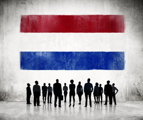 Silhouettes of Business People With Netherlands Flag