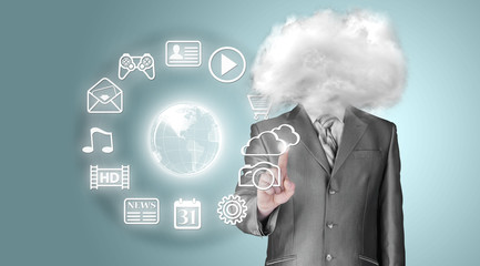 Young businessman with head in the clouds