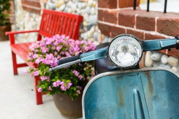 classic motorcycle with red bench