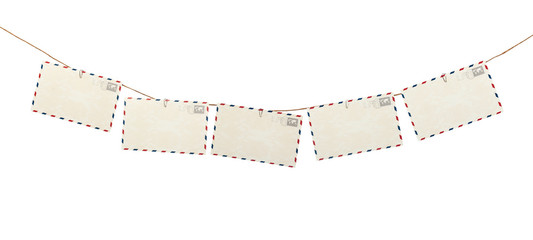 Row of blank post cards hanging on a rope isolated