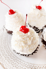 cupcakes with cream and cherry