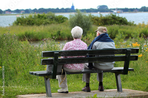 canvas print picture Two people on a bench
