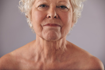 Mature woman face with wrinkled skin