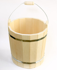 wooden bucket for a bath on a white background