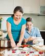 Family cooking berries dumplings