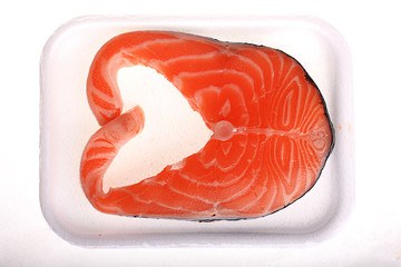 fresh salmon in the box on a white background