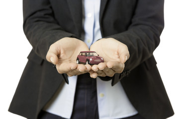 business woman presenting a toy car