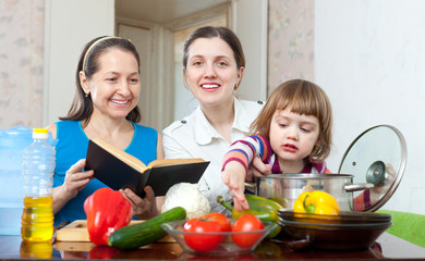 women cook vegetables in the kitchen