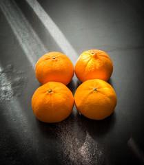 Oranges set on wooden base
