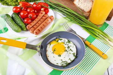 Scrambled egg with sausage and vegetables served