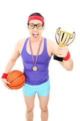 Basketball player holding a golden trophy