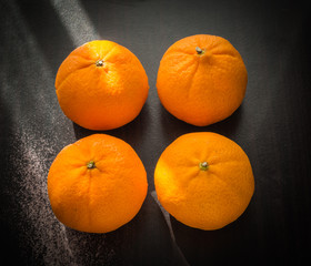 Oranges set on wooden base
