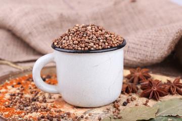 Metal round mug full of seasoning