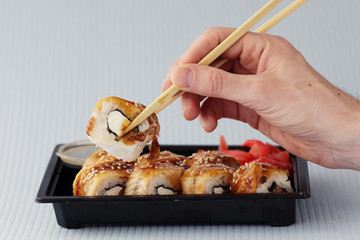 hands sticks japan rolls