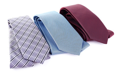Brown, blue and grey ties on white background isolated
