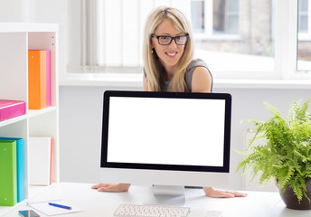 Woman showing blank presentation on computer screen
