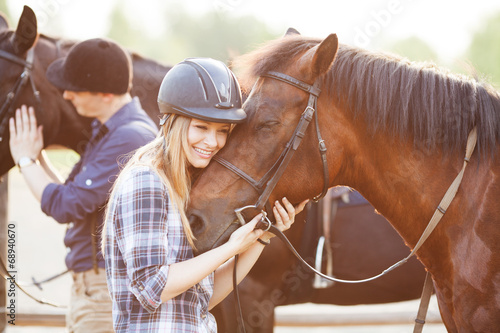 Woman hugging horse and expressing joy and heppines - 68940670