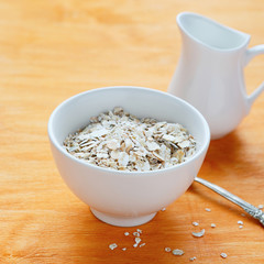 flakes in a white bowl and jug