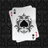 two aces playing cards on black damask pattern(spades)