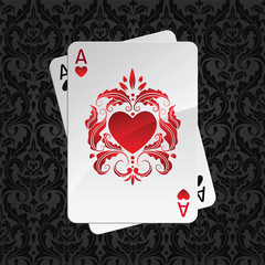 two aces playing cards on black damask pattern(hearts)