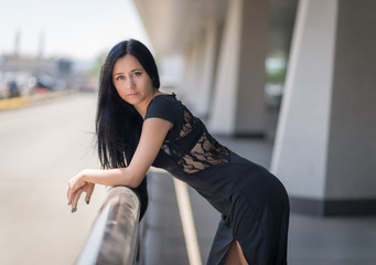 Photo of beautiful lady in elegant evening dress, outdoor.
