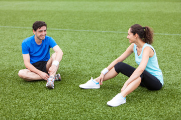 Sport coach training a young attractive woman