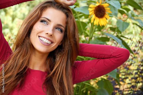 beautiful woman in an autumn garden - 68943605