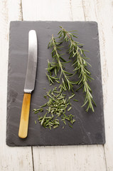 rosemary and knife on slate