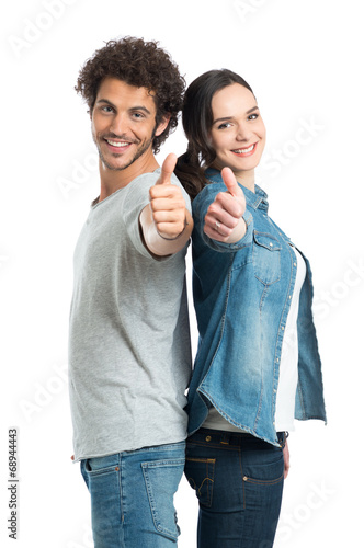 Young Couple Showing Thumb Up - 68944443