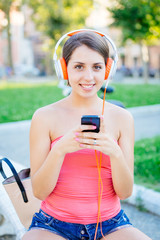 Beautiful Girl with Mobile Phone at Park