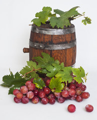 wine barrel and red ripe grape