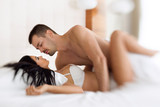 Fototapety amorous couple making love in bed