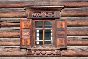 window of a house with wood carvings