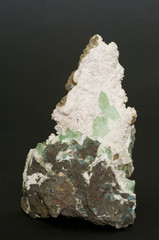Green Apophylite on Laumontite from Pune, India. 12.4cm high.