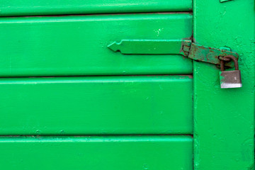 Green Door with Lock