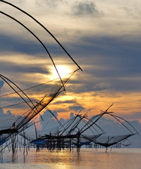 landscape of square dip net at sunrise time from thailand